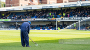 The groundsman is making the final preperations for the match